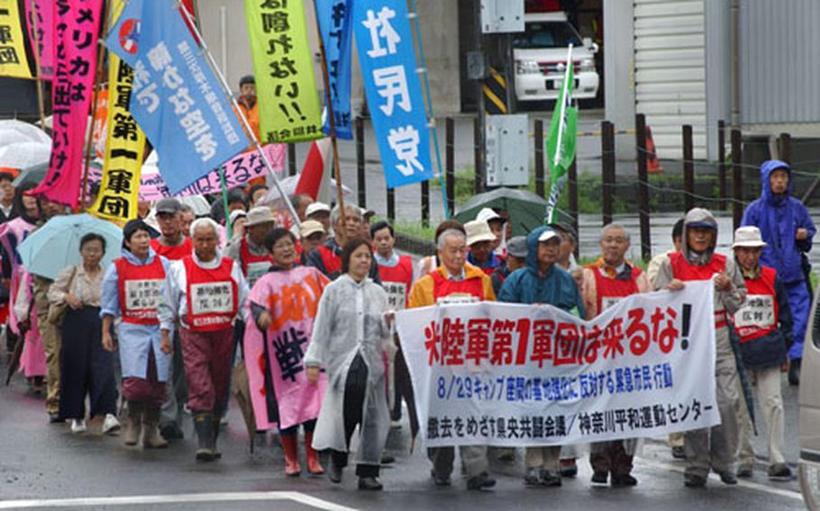 Japanese protestors, demonstrating in opposition to unconfirmed reports of Army troop movement plans, march together from Sobudaimai Train Station to Camp Zama's Main Gate Sunday.