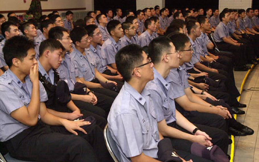 """A group of Korean National Police listens to a briefing on Yongsan Garrison Monday. The group, which normally provides security outside the base gates, was given an """"appreciation day"""" on base."""