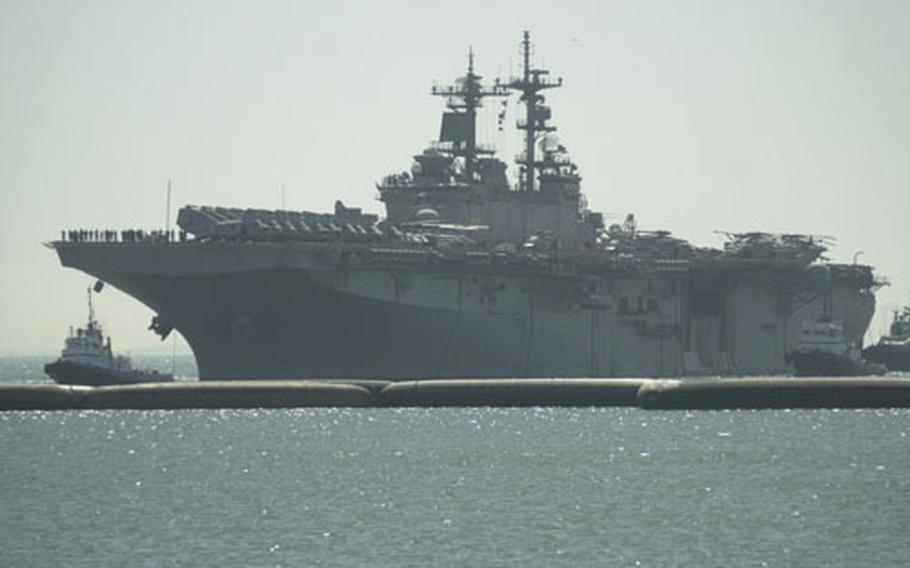 The amphibious assault ship USS Wasp pulls into Naval Station Rota, Spain's port on Tuesday.