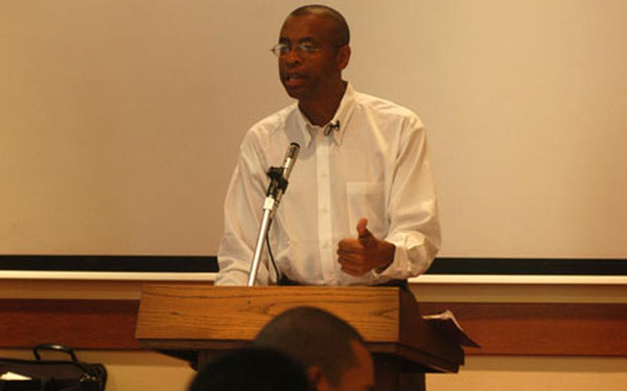 """Poet, author and """"literary activist"""" E. Ethelbert Miller makes a point Tuesday during a presentation to soldiers at Caserma Ederle in Vicenza, Italy. Miller and novelist Richard Bausch encouraged soldiers, many of whom deployed to Iraq and will soon head to Afghanistan, to put their experiences to paper. Their visit was part of the National Endowment for the Arts' Operation Homecoming – designed to document wartime experiences."""