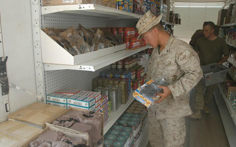Cpl. Gee Vue of Marine Service Support Group 11 shops at the Camp Duke, Iraq, post exchange on Wednesday. Vue and a few other Marines and soldiers helping to open the exchange were able to shop before Friday's planned opening.