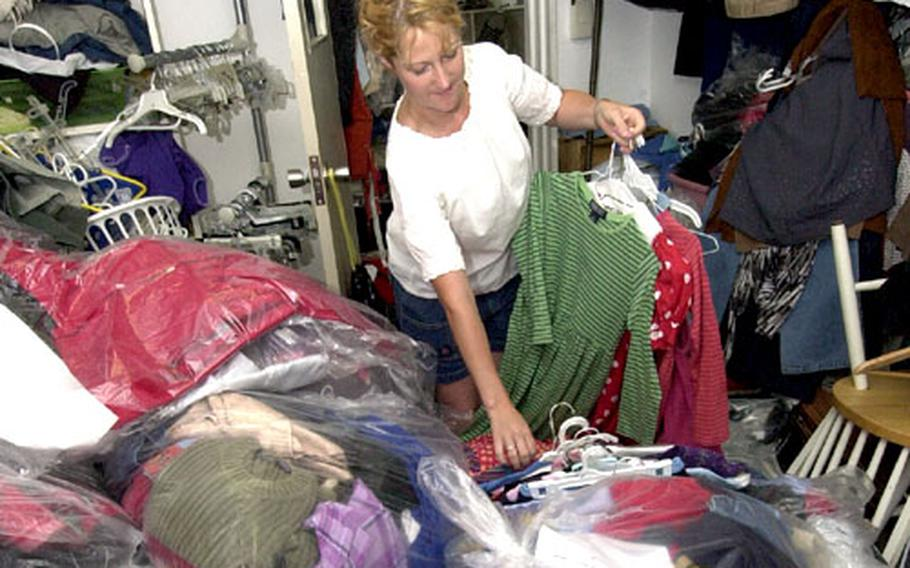 Esther Seep sorts through a pile of donated clothes at the Second Hand Rose shop on Yokosuka Naval Base.