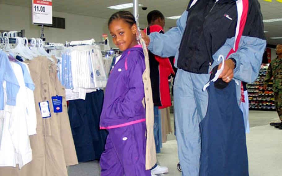 Kimberly Robinson shops for new school clothes for her daughter, Kaylah, 6, at the Bamberg Post Exchange in Germany. Bamberg schools have adopted a school dress code for students.