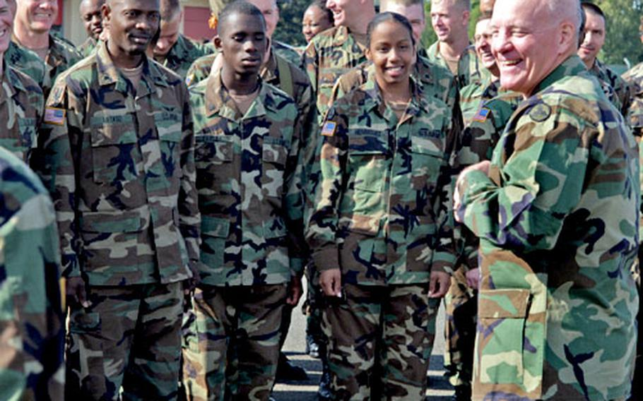 Army Brig. Gen. Vincent E. Boles, right, talks with his soldiers during change-of-command rehearsals Wedesday at Wiesbaden Army Airfield, Germany. On Thursday, Boles turned over command of the 3rd Corps Support Command to Brig. Gen. Rebecca Halstead.