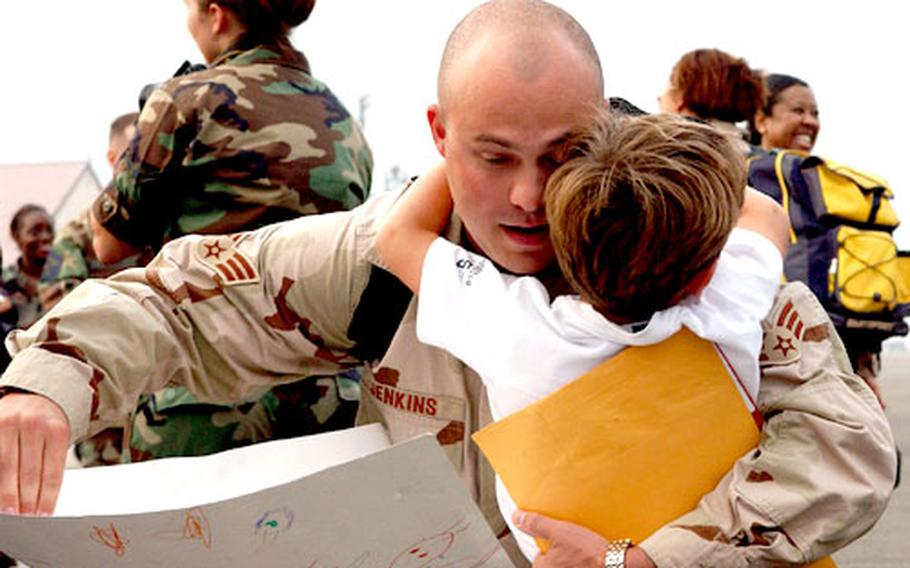 Senior Airman Frank Jenkins of the 374th Civil Engineer Squadron is welcomed back to Yokota from deployment by his son, Ethan
