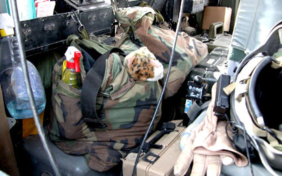 A stuffed tiger belonging to Sgt. Reginald Jones rides in the back of a helicopter as Jones' unit heads out on missions.