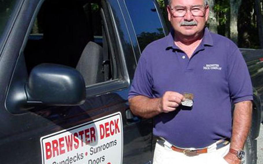 """Vietnam veteran Ken Archambault holds a set of dog tags with his name and his identification number stamped on them that 35-year-old Stacey Hansen said she found while backpacking in Vietnam four years ago. A few years ago, Hansen called Archambault, telling him she'd found his tags. """"I didn't remember losing them,"""" he said. Real or not, Archambault said he wanted to have them."""