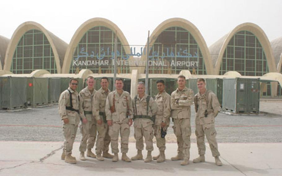 Sailors from Misawa's Fleet Maritime Patrol Mobile Operational Control Center-Western Pacific pose for a photo while deployed to Kandahar, Afghanistan.