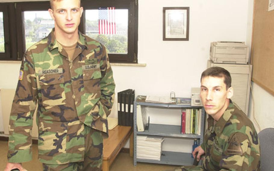 Spc. Joshua Reasoner, left, and Staff Sgt. Eric Knott in Knott's office at battalion headquarters.
