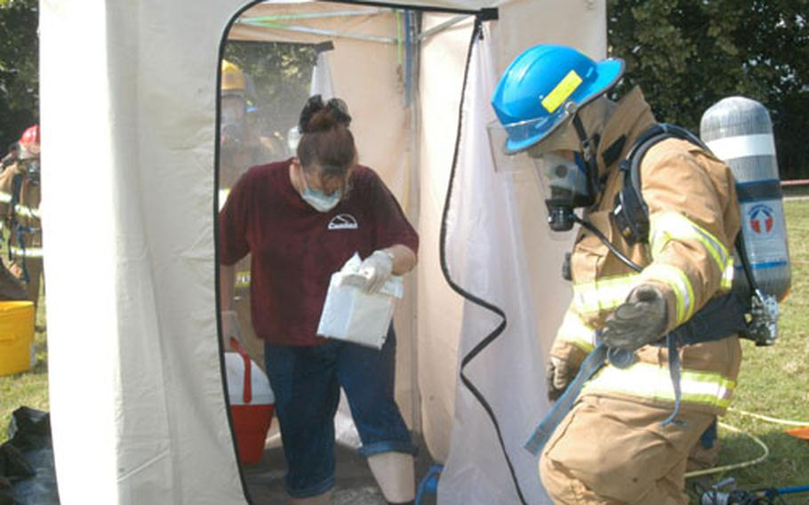 A mock biological contamination casualty exits a decontamination shower during an emergency response exercise held in July at Camp George in Taegu, South Korea.