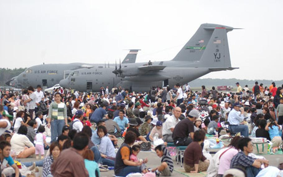 About 200,000 people were expected at Sunday's annual Misawa Air Festival, hosted by the U.S. Air Force and Japan Air Self-Defense Force. It's one of the largest air shows in northern Japan. Due to low cloud cover, most of the high-flying aerial demonstrations were canceled or modified but more than 40 U.S. Air Force, Navy and Japan Air Self-Defense Force aircraft lined the south ramp of the runway for visitors to view.