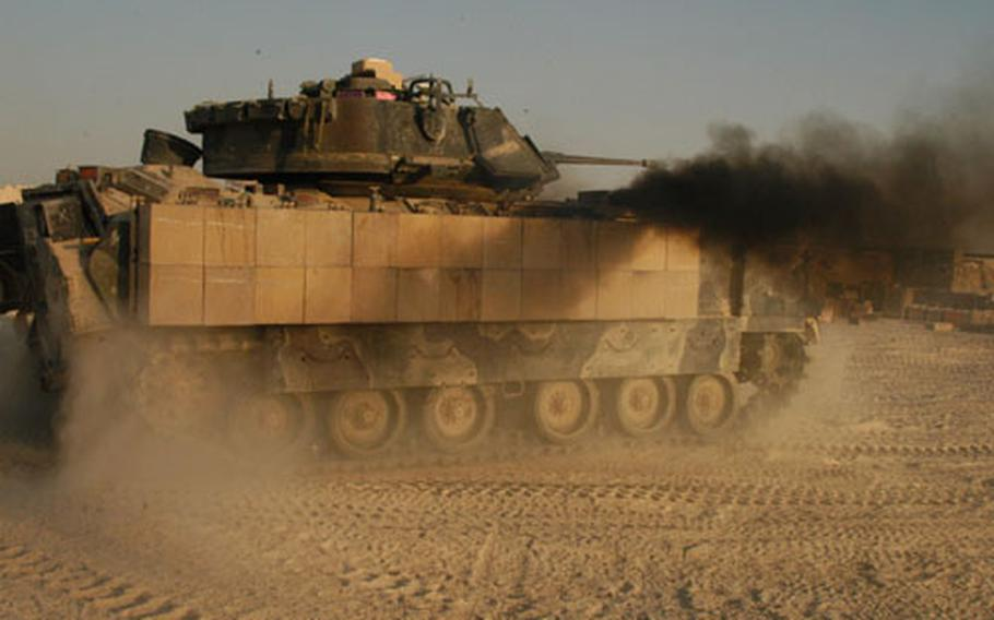 One of the Manchus' Bradley fighting vehicles prepares for action in Iraq across an area of operations that covers 6,000 square kilometers of desert.