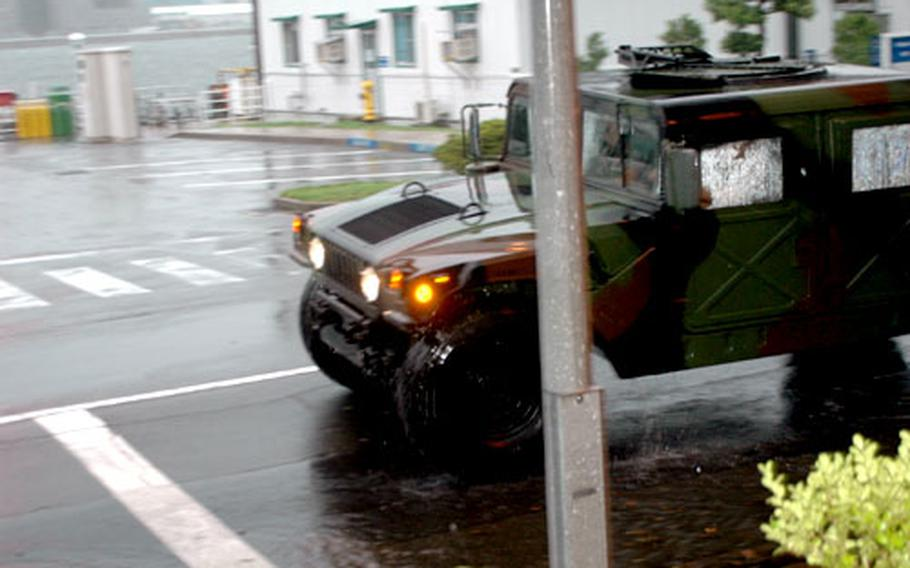 The only vehicles moving on Sasebo Naval Base Tuesday were those operated by the Security Department. The base was closed to all but mission essential personnel.