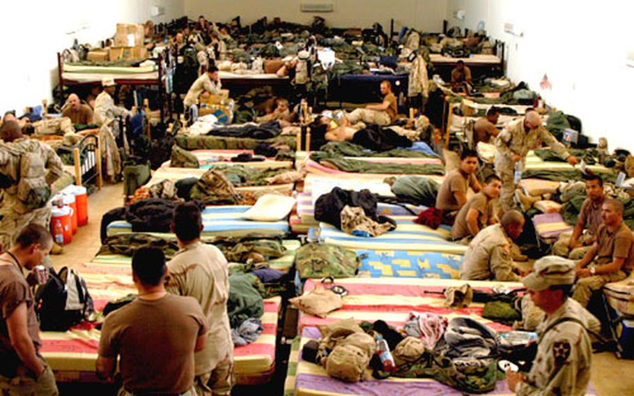 Manchus from 1st Battalion, 9th Infantry Regiment are living in a former morgue while they wait to move in to their barracks in Iraq.