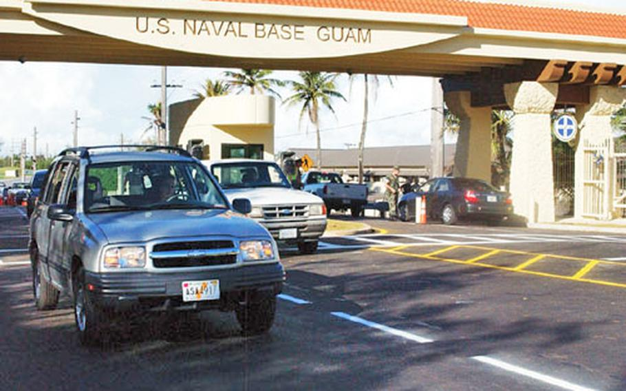 Motor vehicles pass through Naval Base Guam's new front gate for the first time in several weeks after a ribbon-cutting ceremony Tuesday.