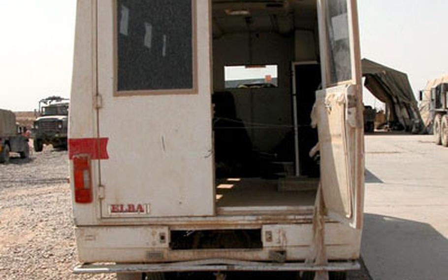 """The hollowed out bus found by the 1st Squadron, 4th U.S. Cavalry """"Bulldawgs"""" still sits in the maintenance yard, its owners apprehended as suspected kidnappers."""