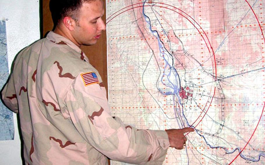 1st Squadron, 4th U.S. Cavalry Capt. Jamie Berry shows the approximate location of where the three vehicles were found.