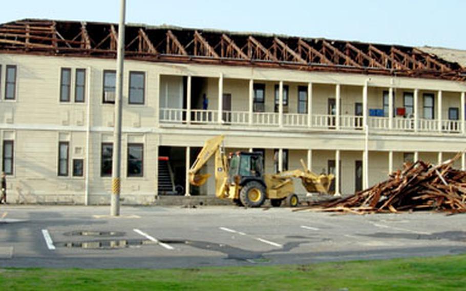 The storm-damaged Logistics Building at Iwakuni Marine Corps Air Station.