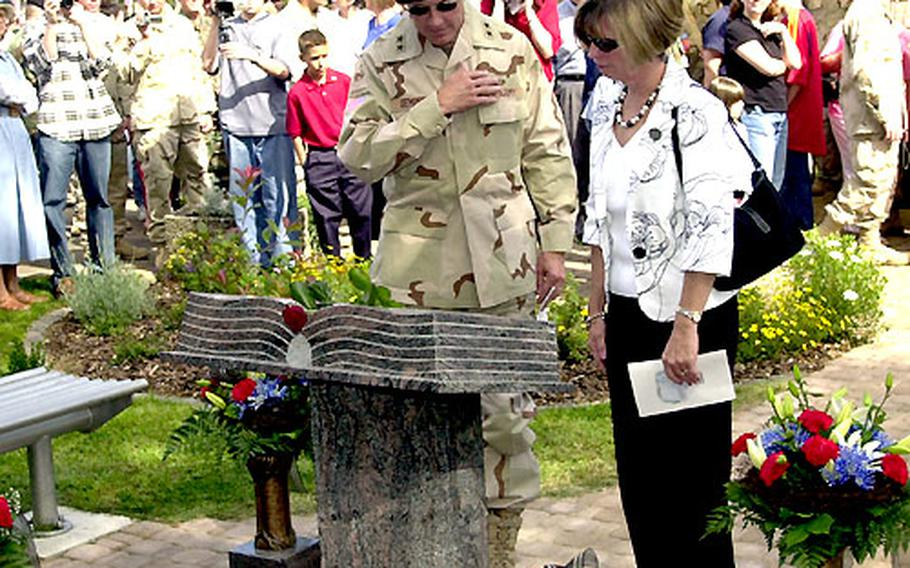 Maj. Gen. Martin E. Dempsey, 1st Amored Division commanding general, and his wife, Deannie, pay their respects Friday at the new memorial to the Baumholder-based 1st AD soldiers who died in Iraq.