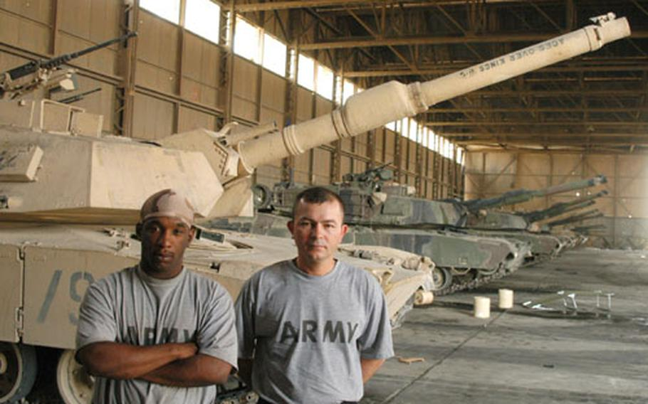 Pfc. Stanley Cuffee, left, an ammunition loader with 2nd Battalion, 72nd Armored Regiment, and Sgt. David Olansoto, a gunner with the regiment, transferred to a new tank after an attack that killed their commander, Staff Sgt. Gary Alexander Vaillant, on Sunday.