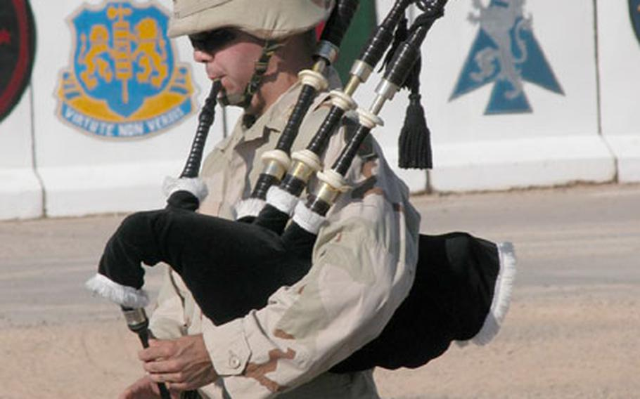 """Second Lt. Lee Tate, of Stanton, Va., plays """"Amazing Grace"""" on the bagpipes during a Sept. 11 ceremony at Forward Operating Base O'Ryan, near Balad. The base is home to the New York National Guard's 2nd Battalion, 108th Infantry Regiment."""