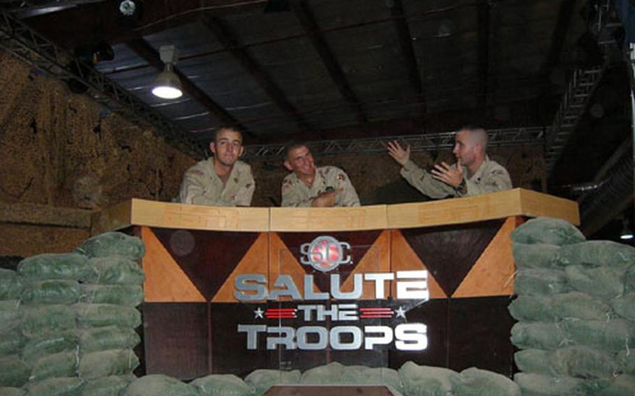 From left, Pvt. Camron Craw, Spc. Michael Curtis and Spc. Lucas Monahan, act out their own version of ESPN's SportsCenter as they were working to build the set last Thursday. Dozens of soldiers took part in creation of the studio and ESPN offices for SportsCenter's live broadcasts next week. Craw, from Minersville, Utah, is assigned to the 32nd Transportation Company; Curtis, from Miami, is assigned to the 50th Area Support Group, and Monahan, from Andalusia, Ala., is assigned to the 175th Maintenance Co.