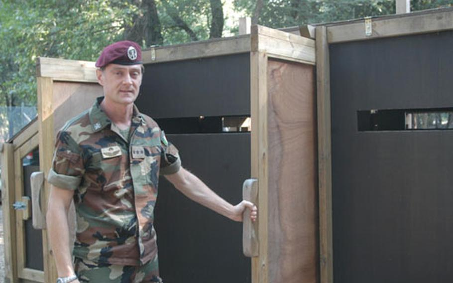Capt. Paolo Biachesi, the deputy Italian base commander at Camp Darby, talks about a series of fences and gates that will be used to round up deer in the coming months.