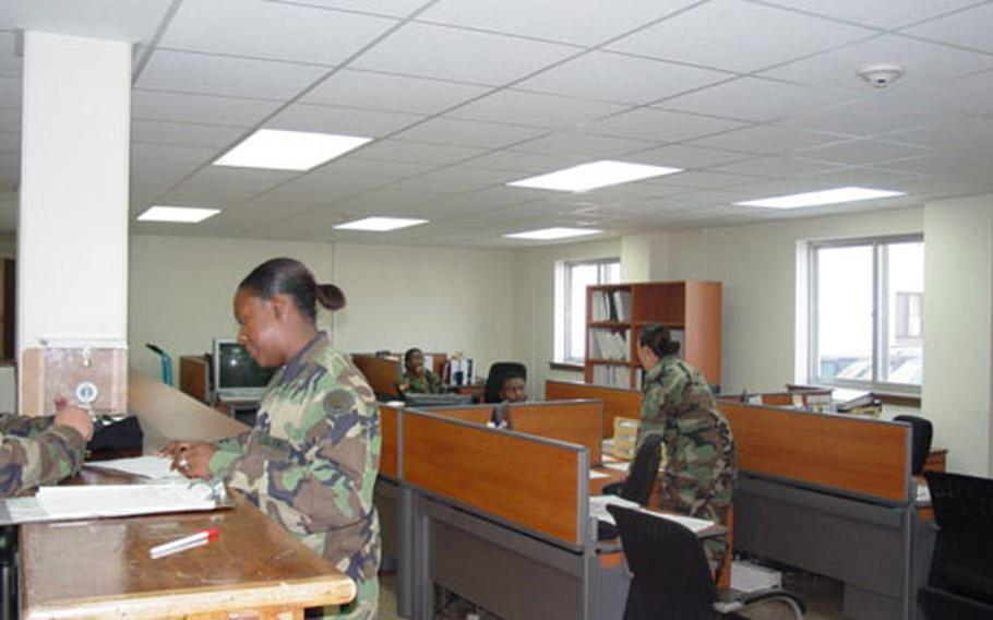 """Soldiers of Army's 176th Finance Battalion at work in a newly-renovated building on Camp Humphreys in South Korea. Base officials will use the three-story former barracks to house a one-stop in- and out-processing center for troops, and for other key """"quality-of-life"""" services that soldiers need."""