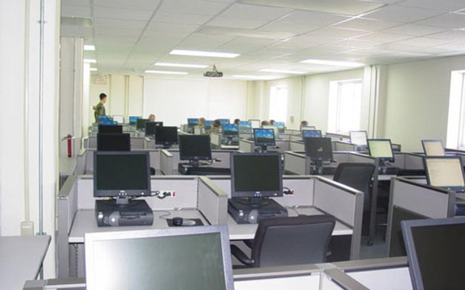 """The new """"one-stop"""" in- and out-processing center inside a newly renovated building at Camp Humphreys in South Korea. The center is equipped with 35 computer work stations."""
