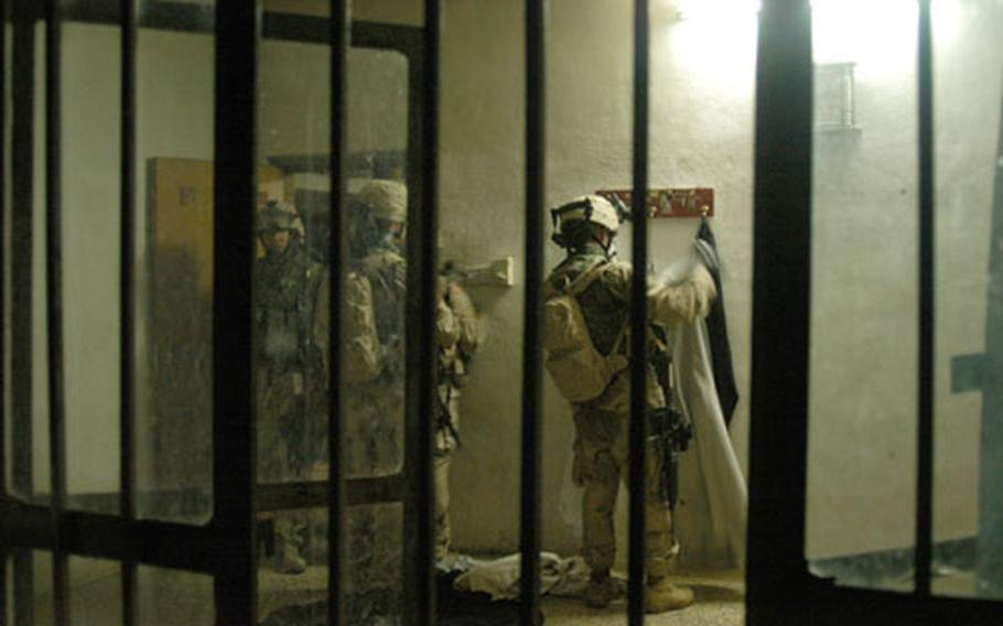Soldiers from Company C, 1st Battalion, 506th Infantry Regiment search a house in Abu Fleis, Iraq, on Saturday.