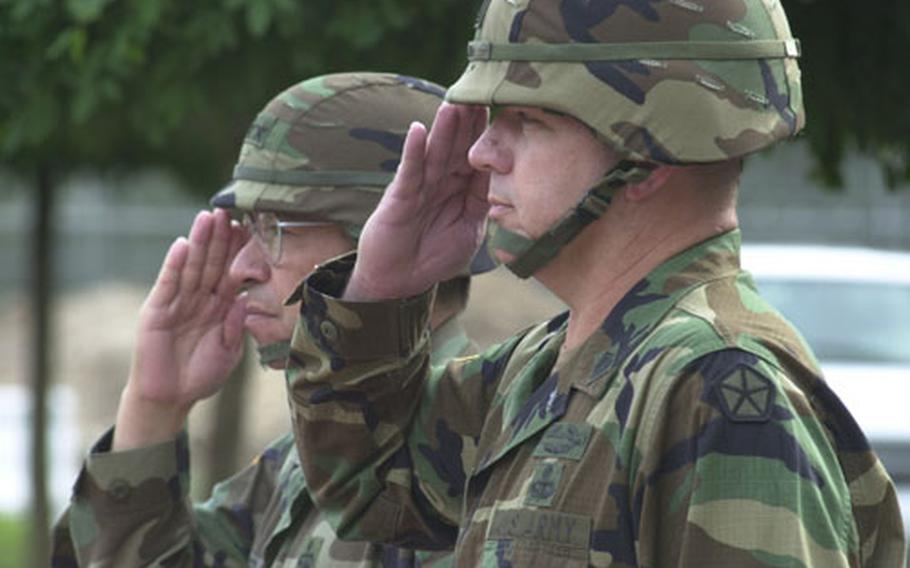 Lt. Gen. Ricardo Sanchez, left, and Command Sgt. Maj. Michael D. Bush salute during a V Corps ceremony welcoming Bush as the new top enlisted soldier of the corps Monday.