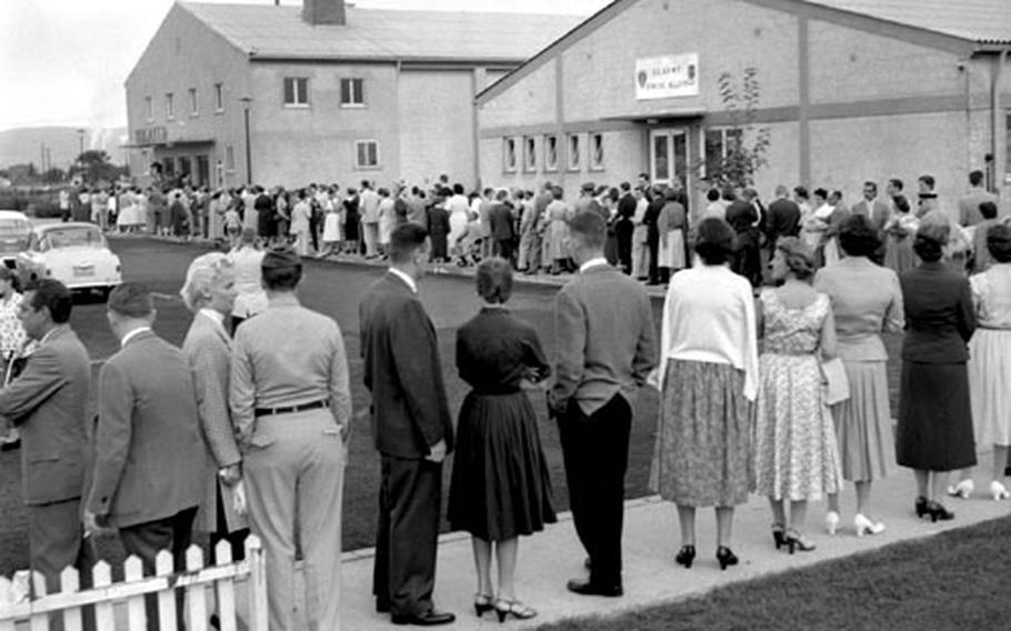 Music fans line up to hear Van Cliburn play at Heidelberg, Germany, August 20, 1958. Those who were unable to get into the theater gathered on the lawn, despite bad weather, to listen through loudspeakers.