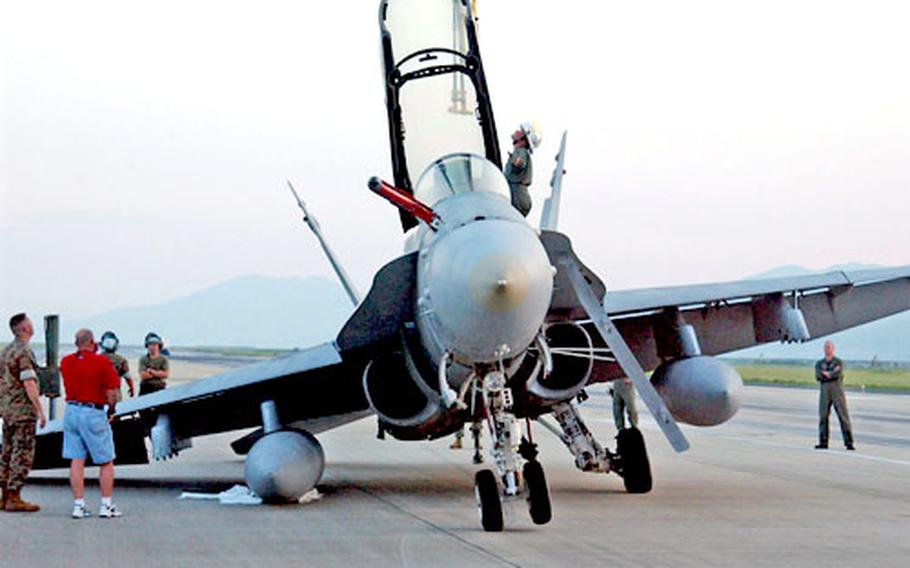 The F/A-18D Hornet shown on the Iwakuni Marine Corps Air Station runway was about 15 minutes from landing Aug. 27 when the right rear landing gear malfunctioned.