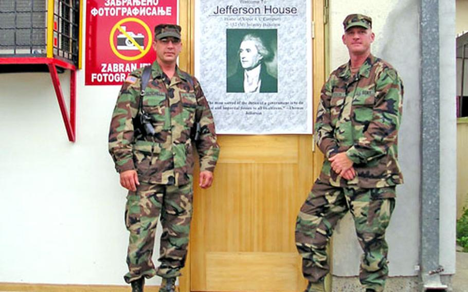 Staff Sgt. Douglas Mitchell, left, and Staff Sgt. Michael Spurgin stand outside the house they and other members of the Indiana National Guard live in in Vlasenica, Bosnia-Herzegovina.