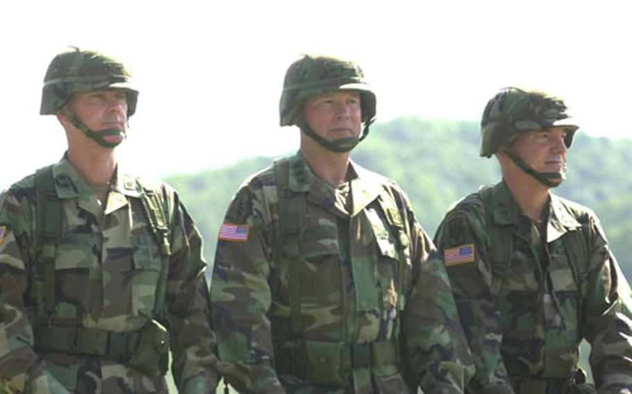 From left, Maj. Gen. George A. Higgins, Lt. Gen. Charles C. Campbell and Maj. Gen. John R. Wood inspect the assembled 2nd Infantry Division troops Tuesday at Camp Casey.