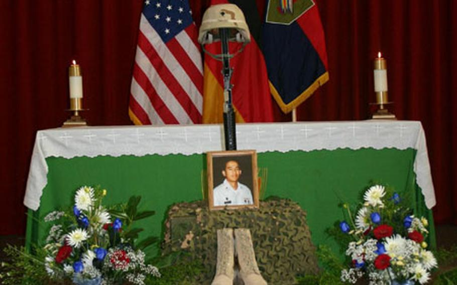 The memorial display for Spc. Edgar Daclan Jr. at a service in the chapel on Ledward Barracks on Wednesday. Daclan, 24, a medic from Cypress, Calif., was killed Sept. 10 in Balad, Iraq, when his patrol responded to indirect fire and was hit by a makeshift bomb.