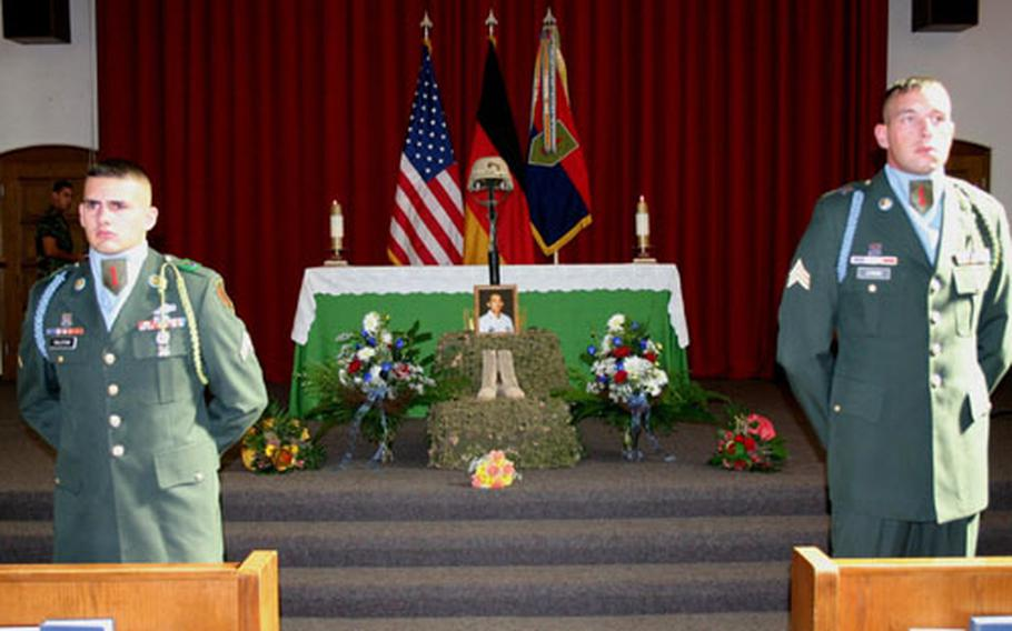 Members of an honor guard flank a memorial display for Spc. Edgar Daclan Jr. at a service in the chapel on Ledward Barracks on Wednesday.