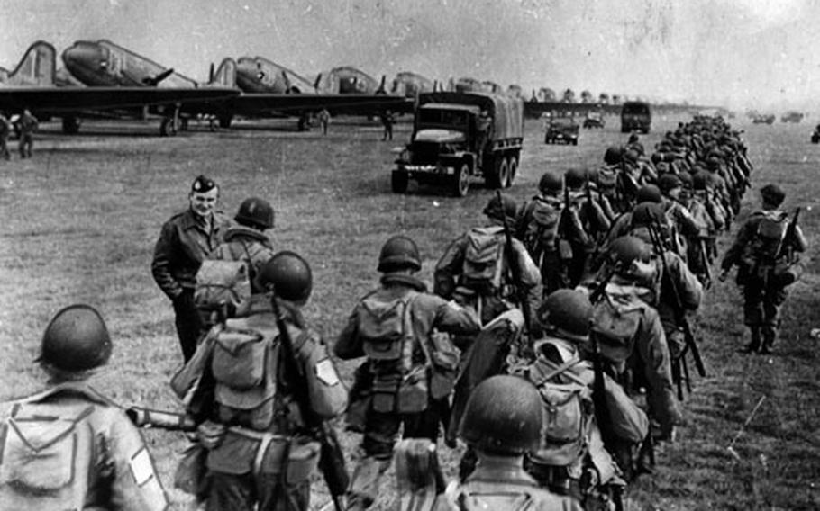 Lines of Allied troops make their way to the loading area of an airfield in England for Operation Market Garden in 1944. It was a major defeat for the Allies, who were still celebrating the successful landings and breakout at Normandy, France.