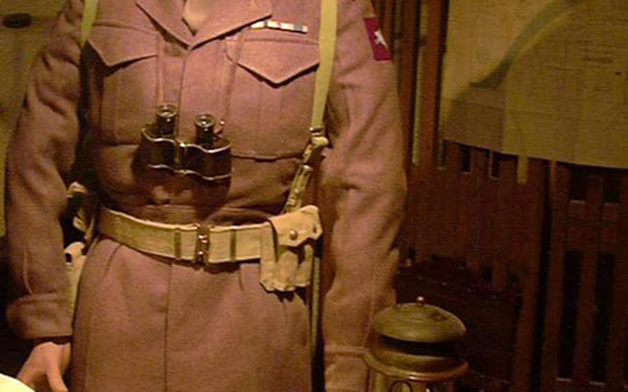 """A figure representing British Maj. Gen. R.E. Urguhart wears the binoculars and beret the general wore in 1944 when he commanded troops from the hotel where the Airborne Museum is now housed in Osterbeek, Netherlands. Sean Connery portrayed the general in the movie """"A Bridge Too Far."""""""