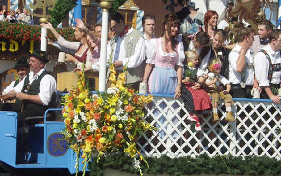 The Lowenbrau float rolls by during Saturday's parade to open the 2004 Oktoberfest in Munich, Germany.