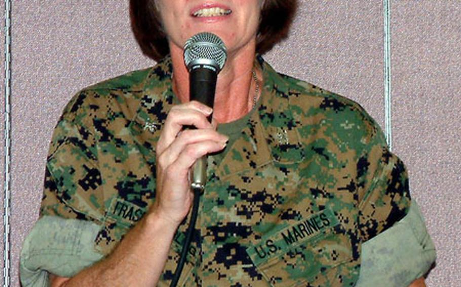 Marine Col. Adrienne Fraser Darling, the new commander of Camps Foster and Lester on Okinawa, addresses a Town Hall meeting on Camp Foster on Thursday night.