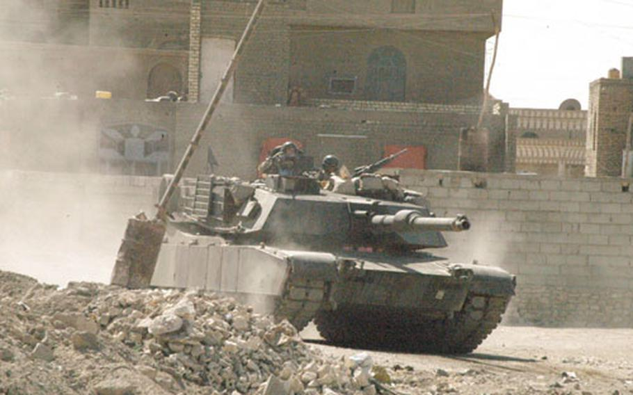 An M1A1 Abrams tank rolls through the streets of Ramadi, Iraq, during fighting with insurgents on Thursday.