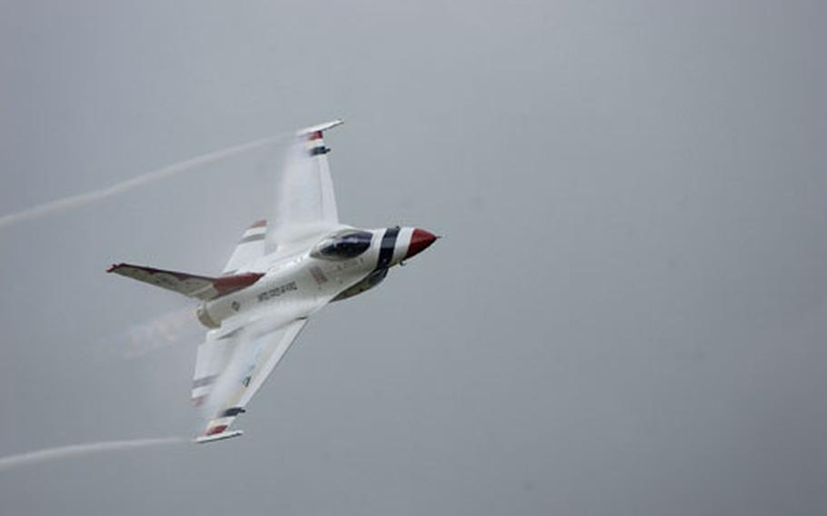 One of the Thunderbirds flight demonstration team, piloted by Maj. Todd Canterbury, flies over the crowd at Sunday's Osan Air Base air show.