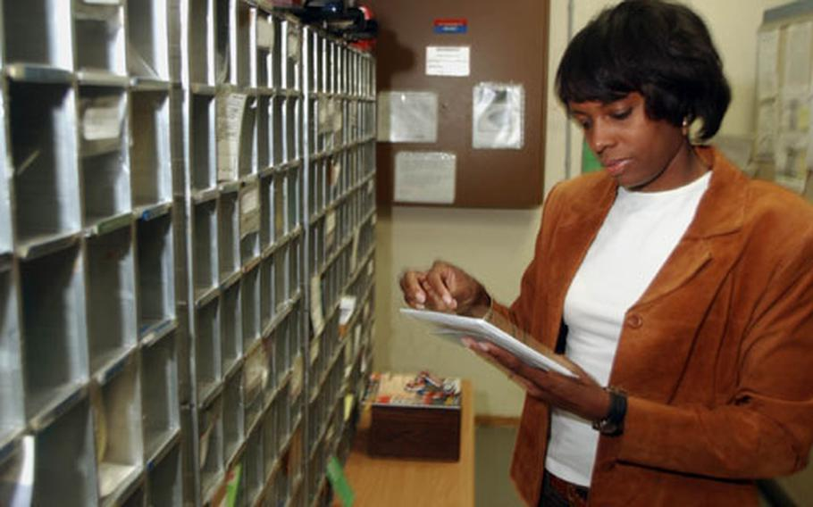 Department of Defense civilians such as Sheryl Cooks, a postal clerk at Rhein-Main Air Base in Germany, could be subjected to serveral changes in the way DOD manages its civilian work force under the National Security Personnel System now being studied.