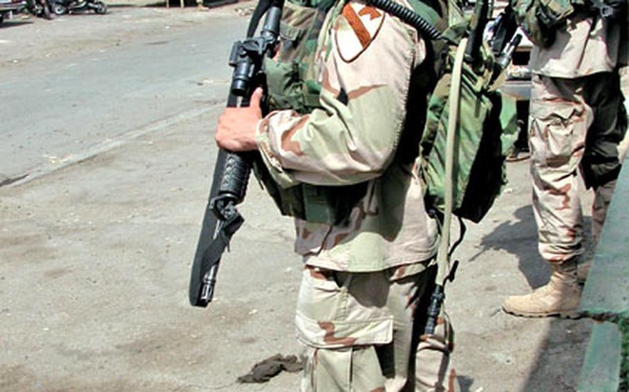 Soldiers from Company C patrol Haifa Street on Sunday.