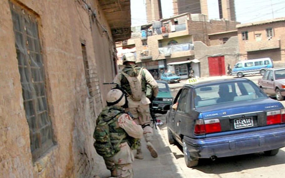 Soldiers from Company C, 1st Battalion, 9th Cavalry Regiment are either on the move during Sunday's foot patrol mission in the Haifa Street area of Baghdad, or they are taking temporary shelter and waiting to make the next move.