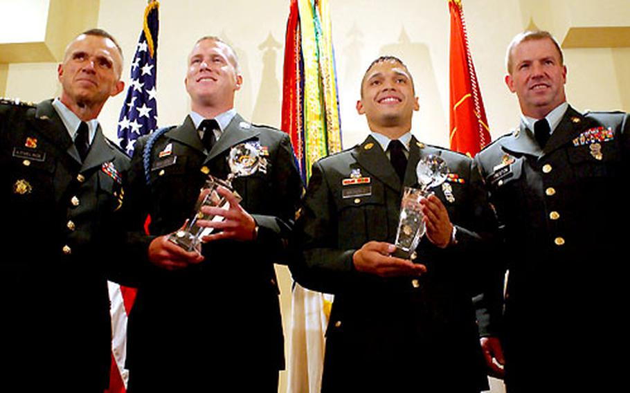 From left, Lt. Gen. James J. Lovelace, director of Army staff; Staff Sgt. Andrew J. Bullock, representing Training and Doctrine Command; Spc. Wilfredo A. Mendez, of 8th Army; and Sgt. Maj. of the Army Kenneth O. Preston at the 2004 Department of the Army Noncommissioned Officer and Soldier of the Year competition ceremony in Fort Myer, Va., on Friday. Bullock and Mendez received their titles after a weeklong testing period. The two will now travel with Preston to Army bases around the world.
