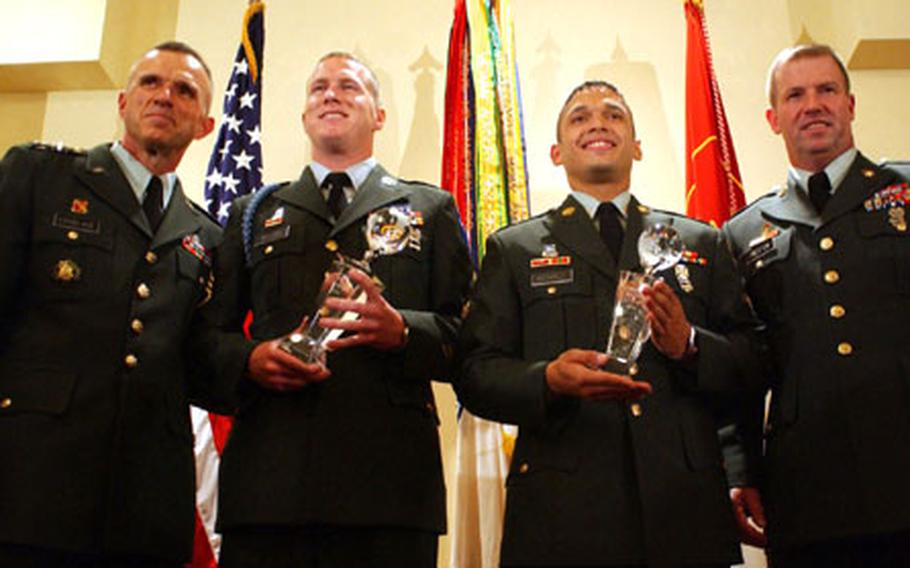 From left, Lt. Gen. James J. Lovelace, director of Army staff; Staff Sgt. Andrew J. Bullock, representing Training and Doctoring Command; Spc. Wilfredo A. Mendez, of 8th Army; and Sgt. Maj. of the Army Kenneth O. Preston at the 2004 Department of the Army Noncommissioned Officer and Soldier of the Year competition. Bullock and Mendez received their titles after a week-long testing period.