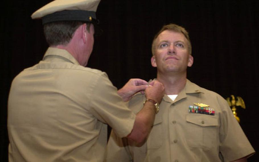 """David Furford is pinned during a ceremony Wednesday at Naval Station Rota, Spain. The ceremony for 13 sailors tapped for the chief petty officer rank had been postponed as the result of """"inappropriate actions"""" at an initiation function on base Sept. 9."""