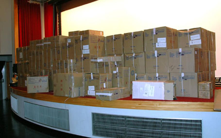 Boxes containing new theater chairs for Sasebo Naval Base's Showboat Theater fill the stage Tuesday afternoon. The theater is undergoing a $425,000 renovation.
